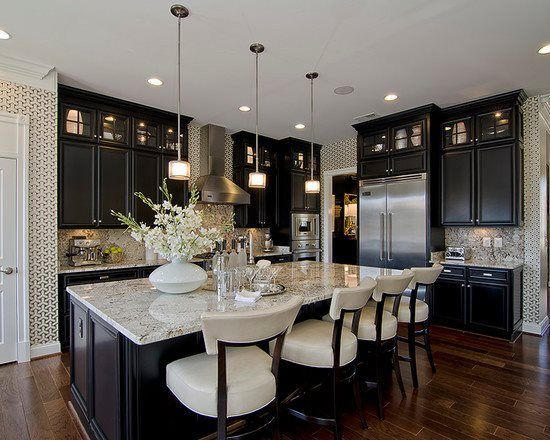 Modern Kitchen: Espresso colored cabinets, hanging light fixtures, stainless steel appliances, granite countertops
