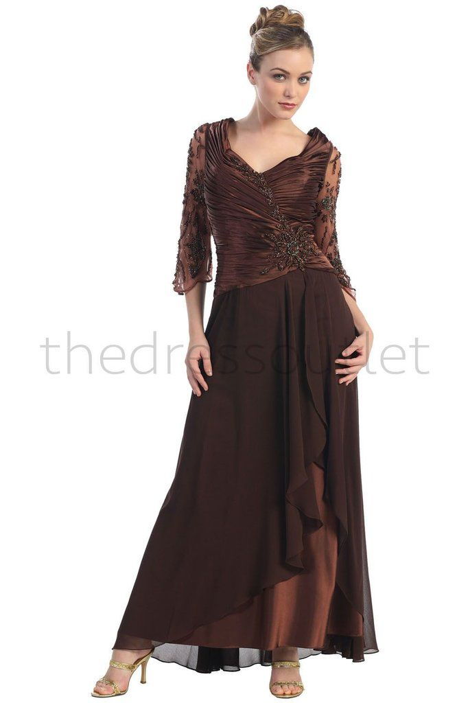 This elegant dress has sheer lace sleeves with a V neck rouched bodice. the skirt is a long floor length with a layer that is higher giving the bottom a beautif