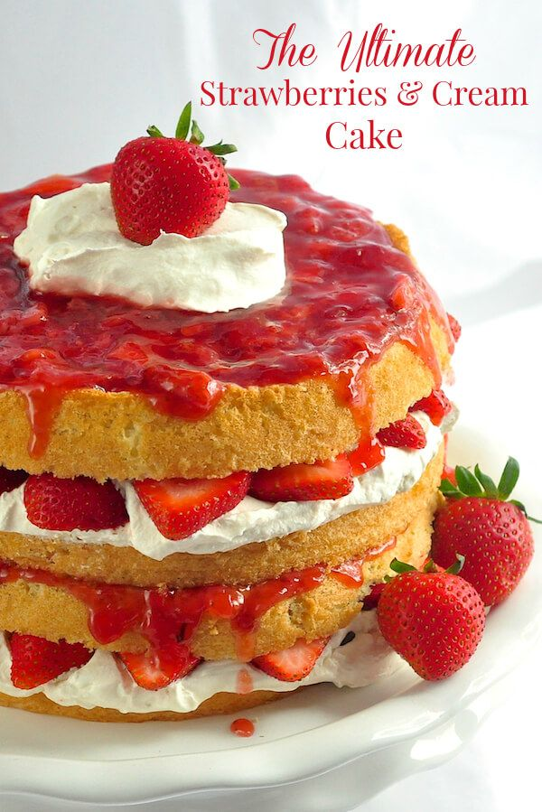 The Ultimate Strawberries and Cream Cake is a light as air sponge cake with fresh strawberries, vanilla whipped cream and strawberry compote.