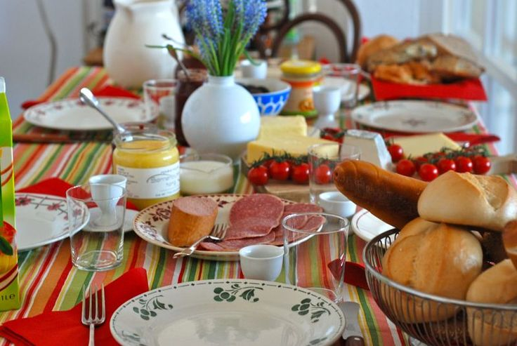 the Germans like to pull out the stops at breakfast (especially weekend breakfasts). Lots of different cheeses, meats, multiple jams and honey, boiled eggs, fruit and vegetables, smoked fish and of course, every kind of roll or hearty, seeded bread your heart could desire.