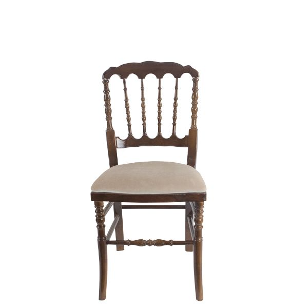 With a regal shape and turned wood details on the backrest and legs, Chesapeake is royal and traditional—blending details from European and American Colonial design. Made with a velvet-soft seat, it sits at standard dining height. Available in white, walnut, black, silver and gold with coordinating seat pad.