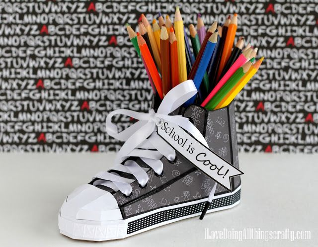 "Ilda  really uses the perfect paper for her super cute High Top Sneaker from BACK TO THE BOOKS SVG KIT.  Wouldn't this look fabulous sitting on the teacher's desk or your child's desk giving inspiration with the saying ""School is Cool"" that Ilda added!   Change out the paper for any theme you like!"