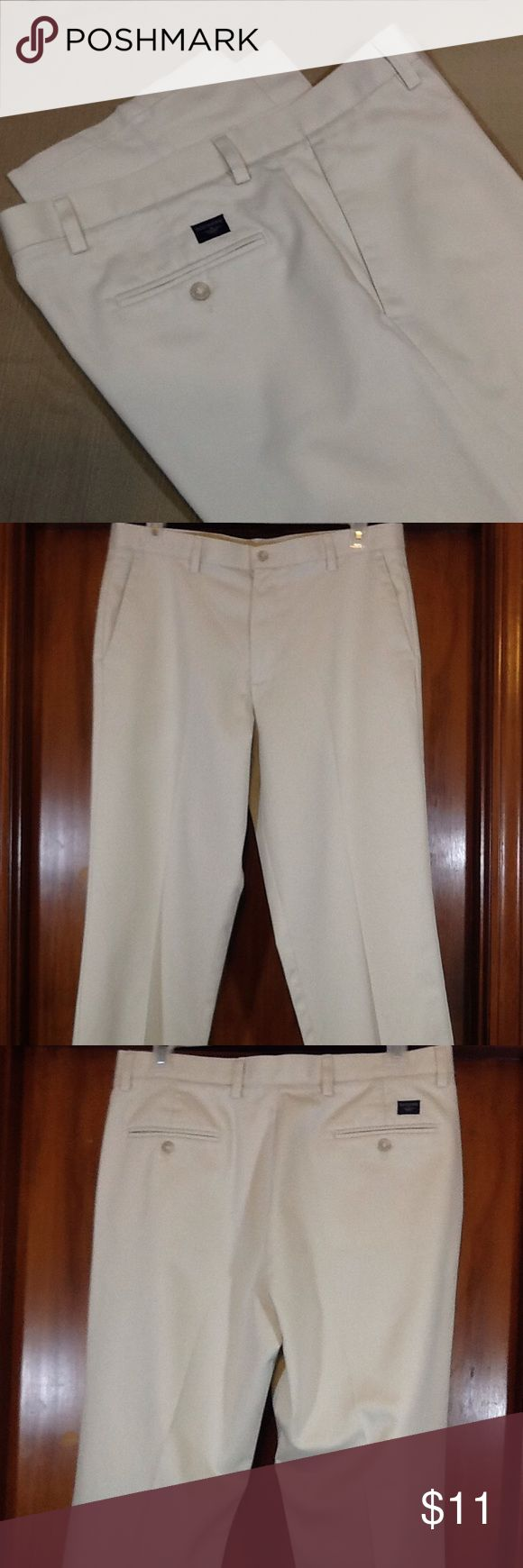 Dockers flat front men's khaki pants Very good pre-owned condition. Stone color, slant pockets in 100% cotton. Actual waist is 36, rise is 12 and inseam is 34 Dockers Pants Chinos & Khakis