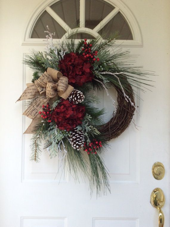 Christmas Wreath ♥♥  This beautiful, sophisticated wreath is a nod to all the traditional elements of the Christmas holiday. Abundant pine boughs, snow covered white pine and frosty cedar branches create a lush evergreen bed on which rests spectacular rich burgundy hydrangea, clusters of vibrant red berries, snowy birch branches and festive snow-tipped pine cones. ...