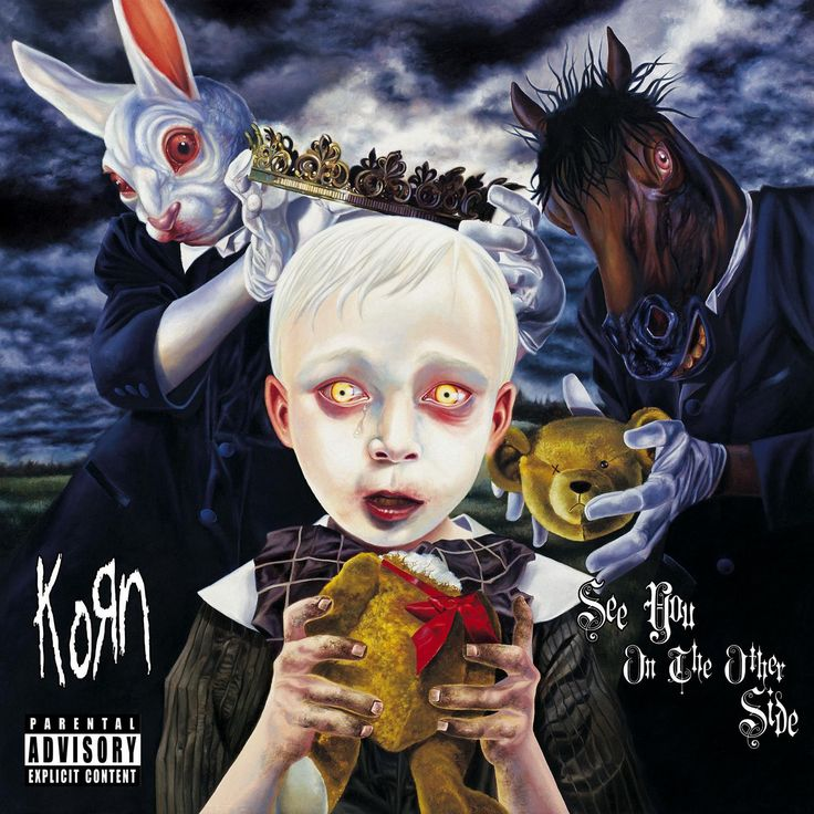 Korn - See You On The Other Side. This is like rock Alice In Wonderland. Probably one of my favorite album pics haha