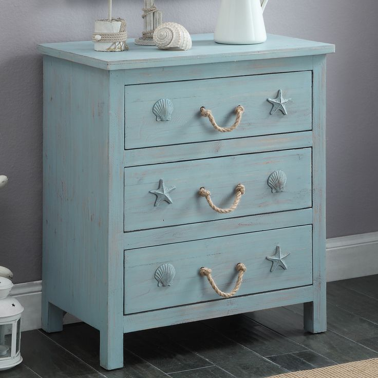 """Features:  -Wood and rope.  -Finish: Blue.  Base Material: -Solid Wood. Dimensions:  Overall Height - Top to Bottom: -29"""".  Overall Width - Side to Side: -24.5"""".  Overall Depth - Front to Back: -15""""."""