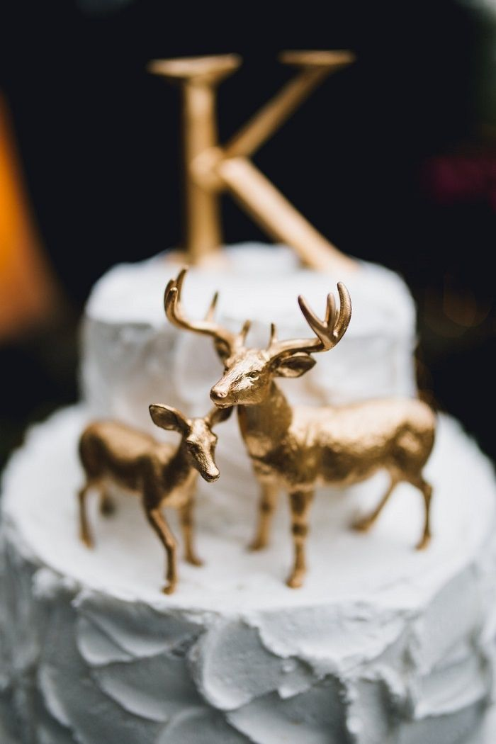 Having a woodland themed wedding? We suggest this metallic gold deer cake topper from LillyOmaDesigns via etsy. #caketopper