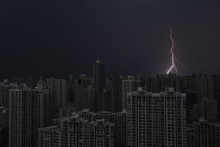 Reuters / Wednesday, August 15, 2012 Lightning is seen above buildings during a storm in central Shanghai, August 15, 2012. REUTERS/Aly Song