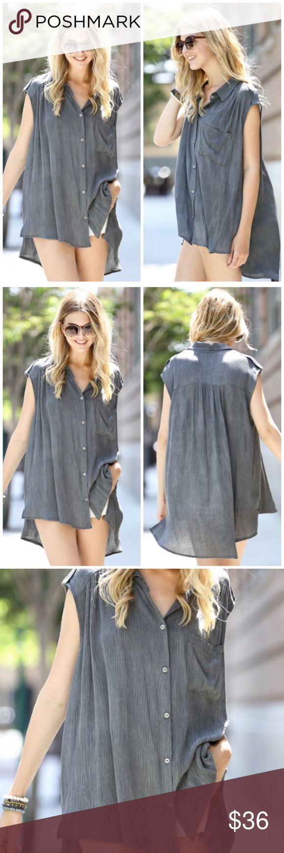 1 HOUR SALEBlack Gray Sleeveless Tunic Top Black Gray sleeveless tunic top featuring V neckline and button down. Loose fitting perfect to pair with jeans, leggings or shorts. Marled 100% Rayon. MADE IN USA Bchic Tops