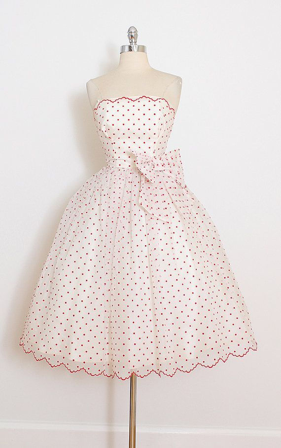 ➳ vintage 1950s dress  * white chiffon * tulle & acetate lining * flocked red polka dot print * bow accent * bodice stays * metal back zipper  condition | excellent  fits like xs  length 37.5 bodice 10.5 bust 32 waist 24  some clothes may be clipped on dress form to show best fit for appropriate size.  ➳ shop http://www.etsy.com/shop/millstreetvintage?ref=si_shop  ➳ shop policies http://www.etsy.com/shop/millstreetvintage/policy  twitter |...