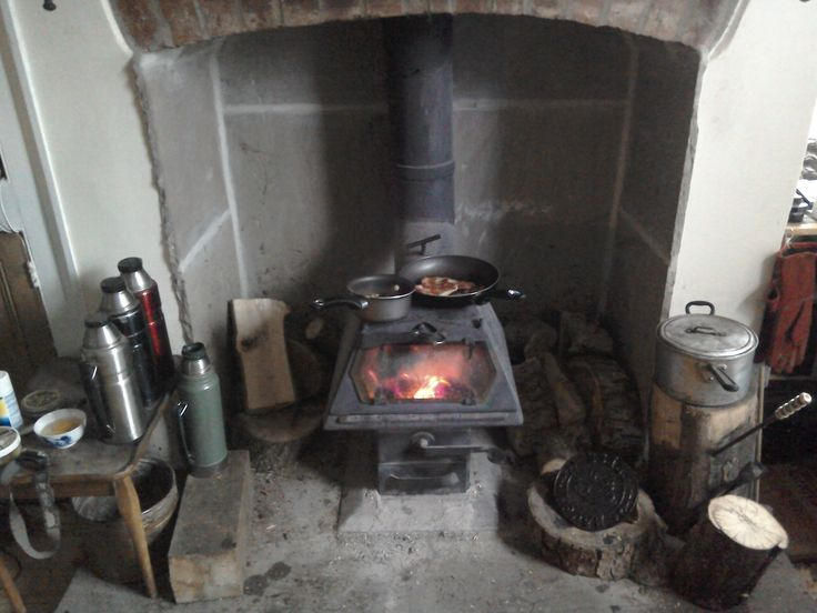 """Not everyone's idea of a shiny living room installation but as Duncan puts it """"with me it's function over form - this stove burns 24/7 from Oct to Apr and 16/07 for much of the rest of the year and doesn't miss a beat, bless it"""". Duncan uses his Hybrid for heating, airing seasoned wood (from a sustainable woodland management plan), drying washing and cooking."""