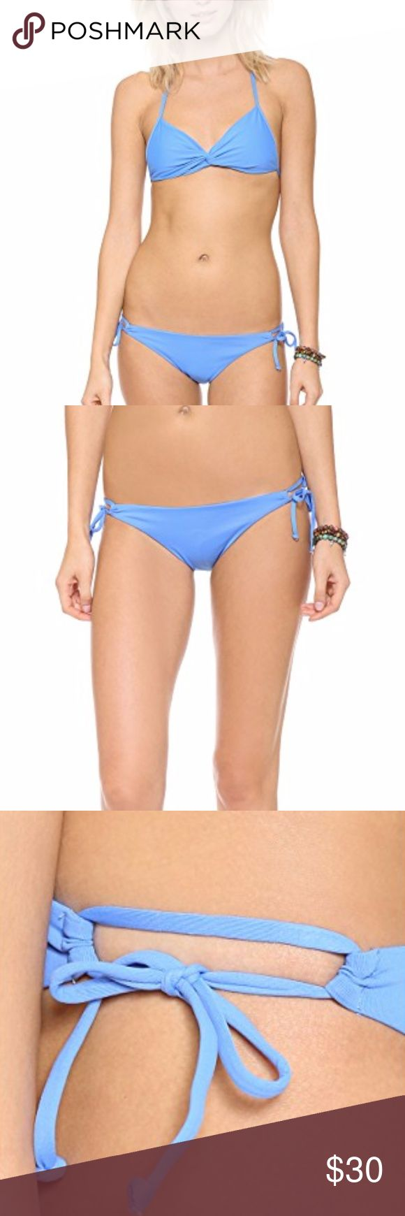 L*Space Sensual Solids Dandy Keyhole Bikini Bottom L*Space Sensual Solids Dandy Keyhole Bikini Bottoms  Ties cinch the cutout sides on these L*Space bikini bottoms, and ruching adds subtle texture to the back. Lined.  80% nylon/20% spandex. Hand wash. Made in the USA. l*space Swim Bikinis