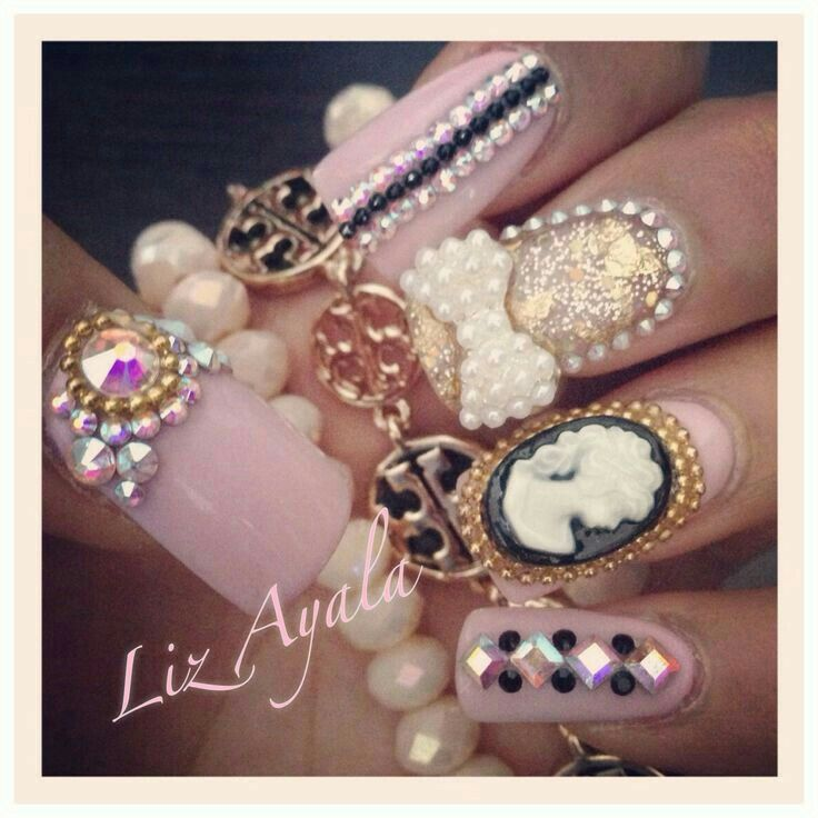 ..pink nails with pearls, rhinestones and cameos and bows..