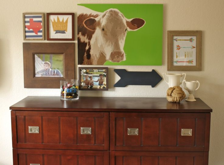 Country-inspired big boy room - we love the modern touches in this gallery wall! #bigboyroom