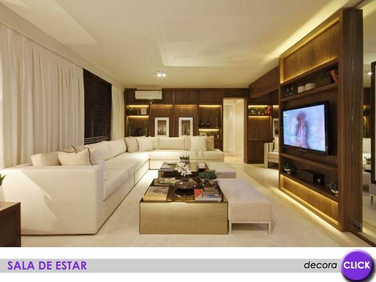Repare que a estante de madeira onde fica a tv usada - Dividir ambientes ...