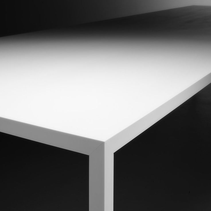 Tense-table, monolithic appearance, by MDF ITALIA