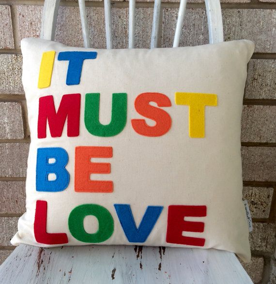 Decorative pillow It Must Be Love word on a by kreativKristine