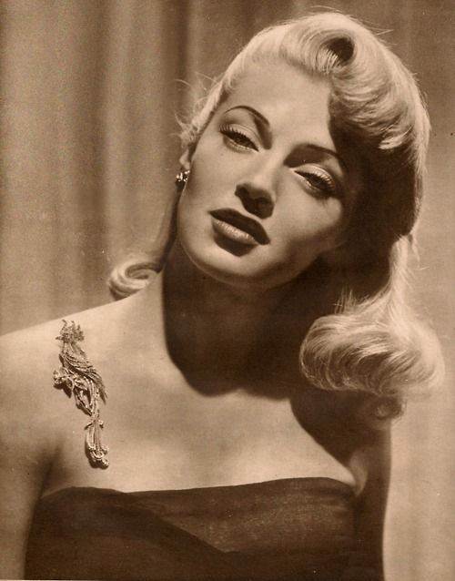 Lana Turner, 1940s. Her floating pin is so cool!