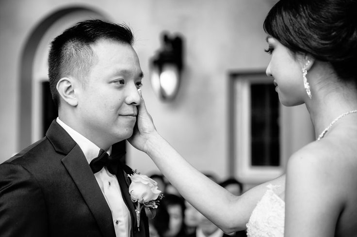 Groom crying during ceremony.