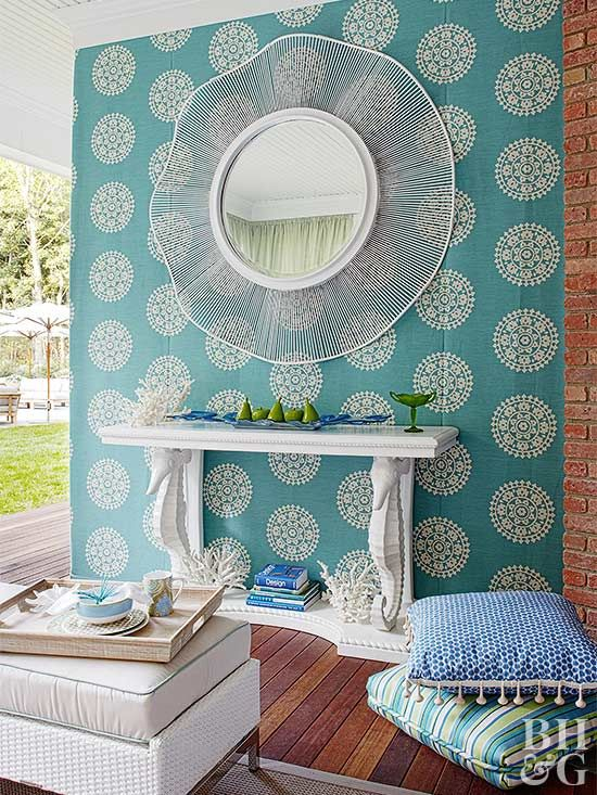 We love the turquoise patterned fabric used to adorn this outdoor room.