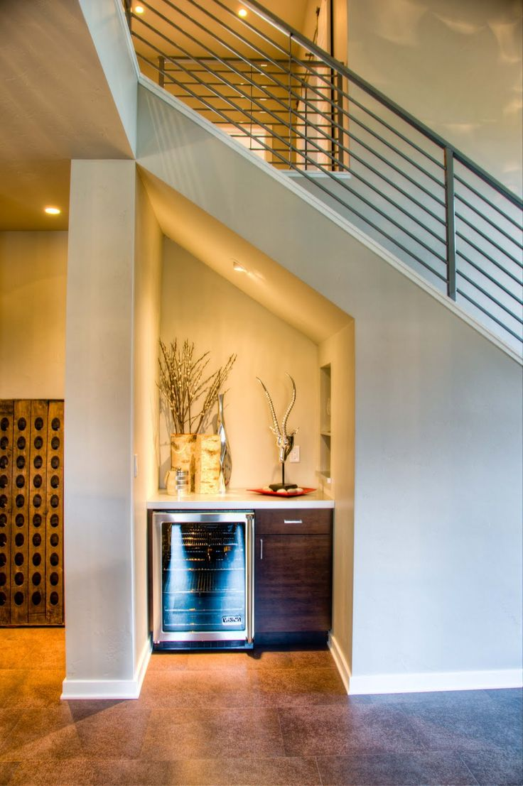Great use of space under stair well. This mini bar has a simple, contemporary design.