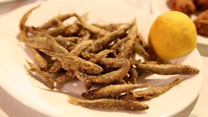 VISIT GREECE  Fried sardines, by David Hoffmann.