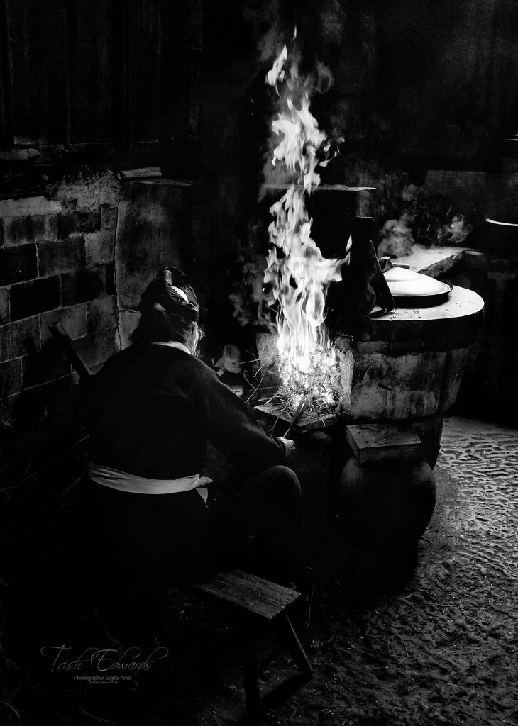 https://flic.kr/p/HG114H | Grandma's kitchen in Ban Yue Li village China | This kitchen fire was raging within no time, its all in the technique
