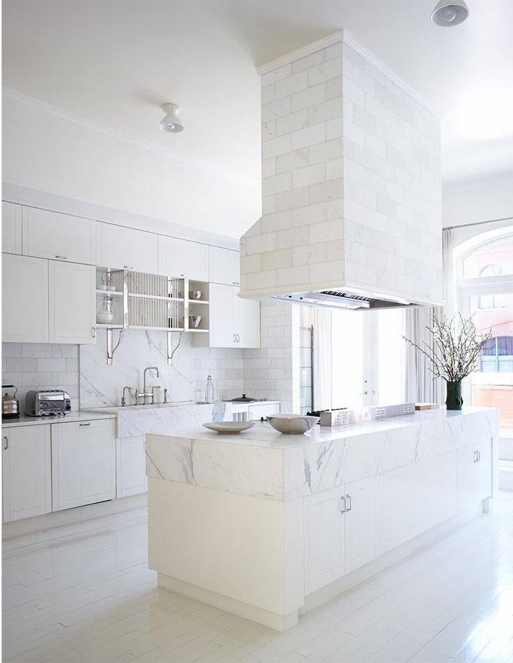 light and airy white kitchen - like the idea of adding side panels to counter top to give the impression of a huge slab of marble