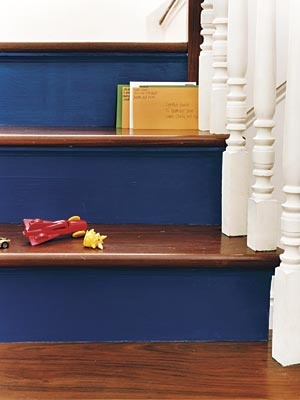 """Paint Stair Risers  Tips and tricks: A dark color in a glossy finish hides scuff marks best. (When risers get nicks, says LaHatt, just """"fill them in with a Sharpie."""") If you want to test colors before committing, cut cardboard pieces to the size of the risers, paint them, and position them on the steps to approximate the effect. When you're ready to go, prime the risers, then add at least two coats of paint. If you wait a day, then add a third coat, the paint will be even more durable."""