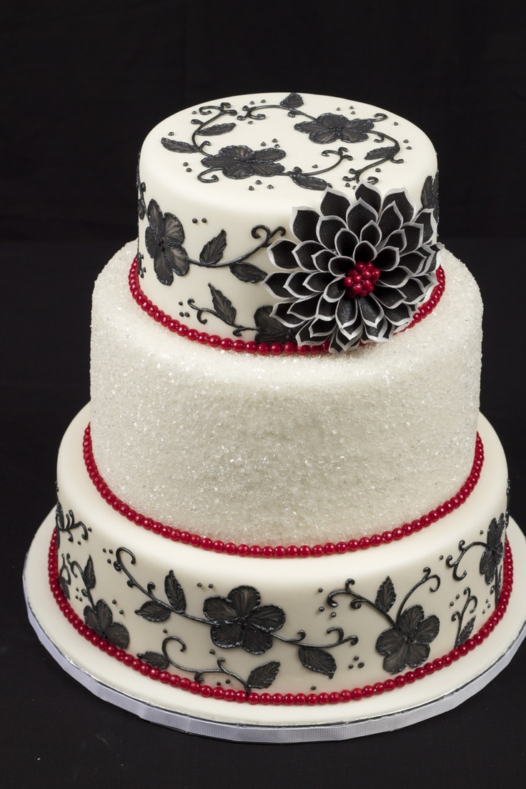 Tiered black, white and red cake