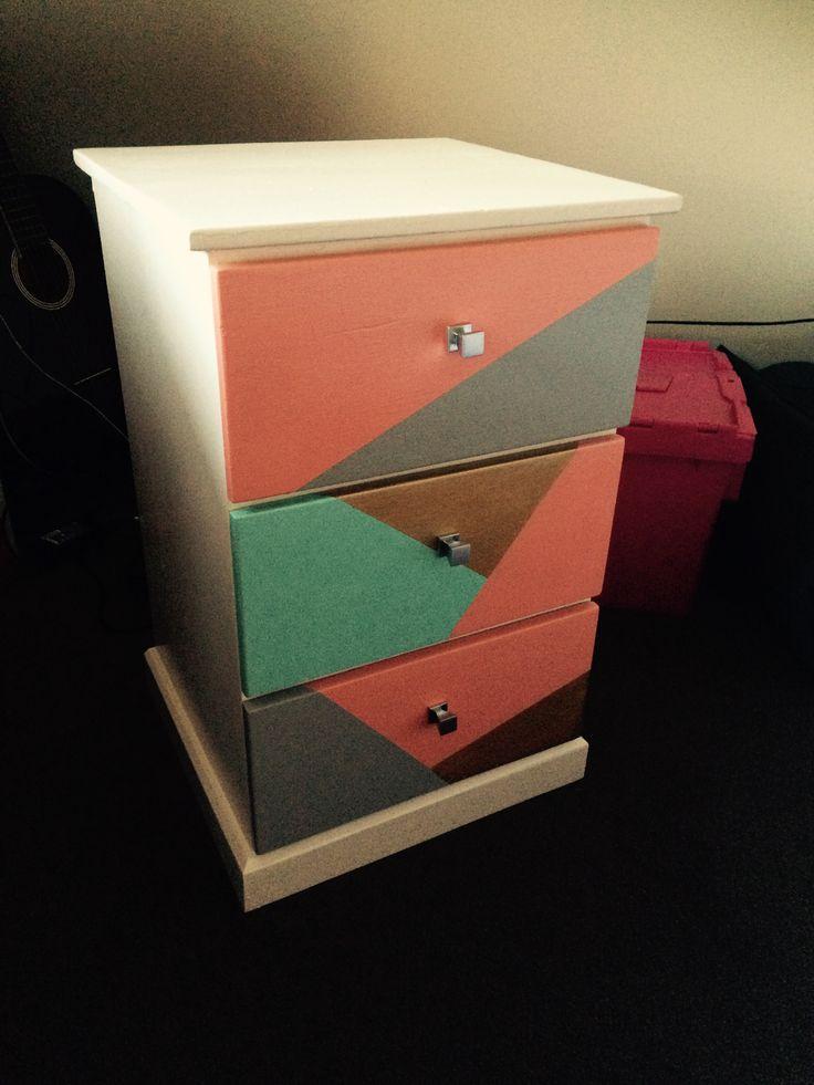 Dark wooden side cabinet repainted in pastel/gold geometric pattern