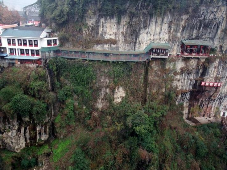 27 Dec 2012, Yichang, Hebei Province, China --- View of the Fangweng hanging restaurant on the cliff of the Happy Valley of Xiling Gorge in Yichang city, central Chinas Hubei province, 27 December 2012. There is a particular mountain in the Hubei Province, 12 km north of the city of Yichang, where tourists can actually experience fine-dining on the side of a cliff. Located in the Happy Valley of Xiling Gorge, the Fangweng hanging restaurant offers a breathtaking view of its natural…