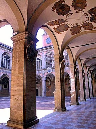 The Archiginnasio Library Courtyard at the University of Bologna. The school is the oldest continually operating university in the world. The Archiginnasio Library is between Piazza Maggiore and Piazza Galvani.