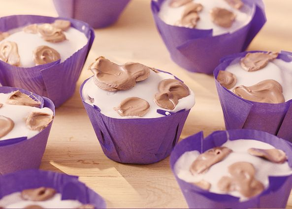 Cadbury Dairy Milk 'mooffins' are a great tasty treat to make and enjoy with the family, topped with white icing and Cadbury Dairy Milk Chocolate Buttons