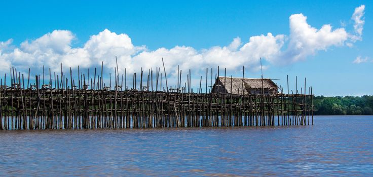 The rivers of West Kalimantan stretch for literally miles, a complex tapestry of waterways.  Fishing pontoons dot them, stark beauty in a now almost unfrequented system.