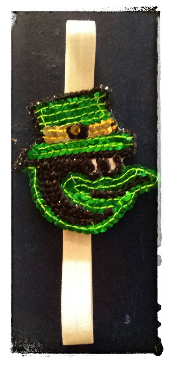 Sequin St. Patrick's day Oriole Bird Opening Day by HeadQuase, $15.00  Sequin St. Patrick's day headband of the oriole bird with a green top hat. What a great way to show your Baltimore Pride and your Irish pride for your St. Paddy's Day festivities! with this flashy Baltimore Orioles Logo wearing a green top hat for St. Patrick's Day. There is no doubt you will stand out whether it is on opening day or St. Paddy's day with this amazing headband!