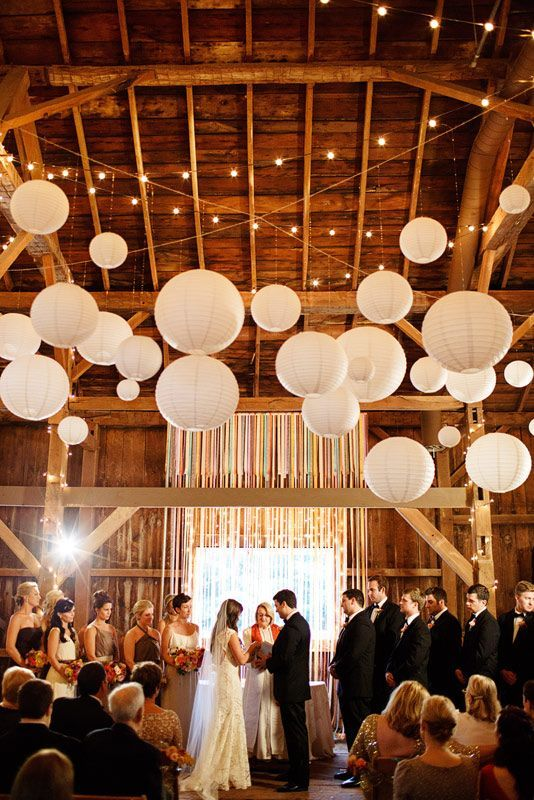 indoor barn wedding decor ideas with paper lanterns and string lights / http://www.deerpearlflowers.com/30-romantic-indoor-barn-wedding-decor-ideas-with-lights/