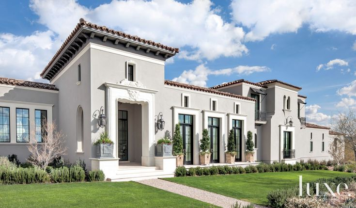 The structure, with its pristine stucco façade, clay tile roof and stately limestone trimmed French doors and windows, is every bit patrician Mediterranean on the exterior.