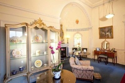 Unlike the other rooms within the house, new features were added and designed by the architect Sir Herbert Baker. He devised an 'Adam revival' scheme that incorporated various features taken from the demolished Harewood House in London.