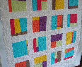 Din cateva petice de materiale uni, cu adaus de material alb, vatelina groasa, cu un binding multicolor si dosul din materiale inflorate,...
