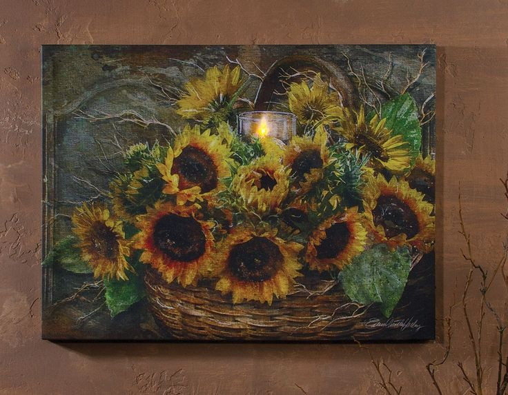 Canvas picture of a basket of sunflowers and candle.  LED battery powered lights cause a flickering light to appear in the candle flame. Item 12072 from the Radiance Lighted Canvas collection at Shelley B Home and Holiday.com
