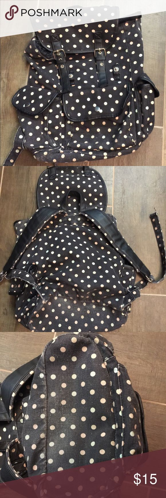 Candies polka dot canvas backpack. Candies polka dot canvas backpack. This is a great canvas backpack. It does show normal wear and fading to the bottom as shown in pictures but overall good shape. Please view all pictures. Candie's Bags Backpacks