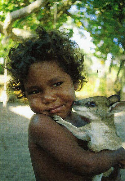 Aboriginal child with a kangeroo or wallaby