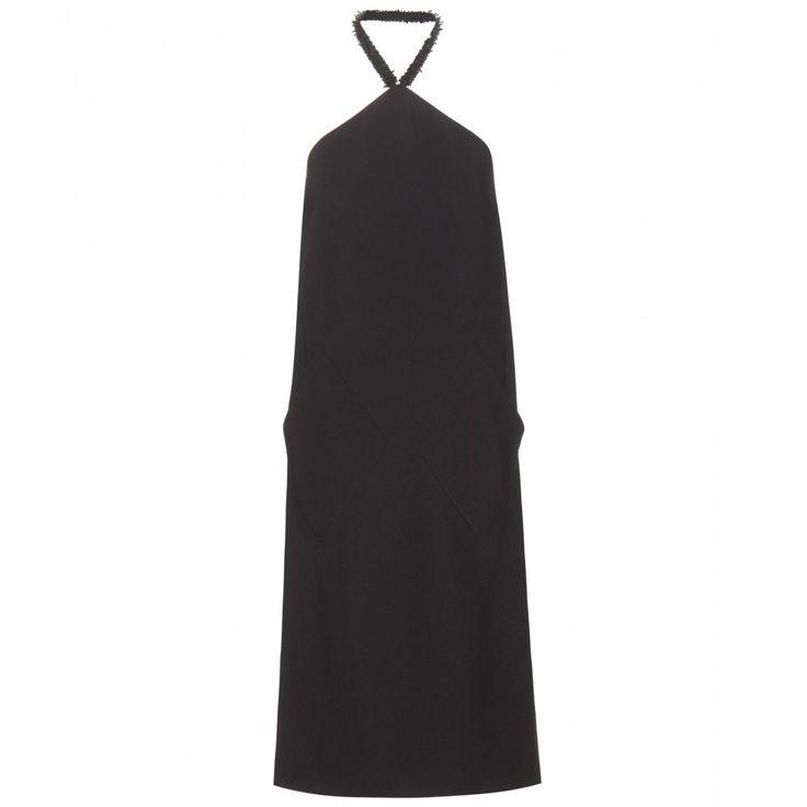 Das kleine Schwarze von Balenciaga zeichnet subtiler Glamour aus: Schwarz glänzende Perlen schmücken den Neckholder, Taschen auf der Vorderseite geben dem Klassiker eine moderne Note. Egal ob zu feinen Riemchensandaletten oder Lackpumps, mit diesem Kleid liegen Sie immer richtig.