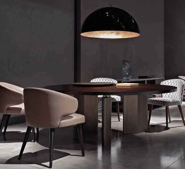Morgan by Rodolfo Dordoni for Minotti is a contemporary interpretation of the traditional refectory table, characterised by a series of sofisticated solutions and the pairing of striking luxury materials. A timeless table which represents the quality of Made in Italy.