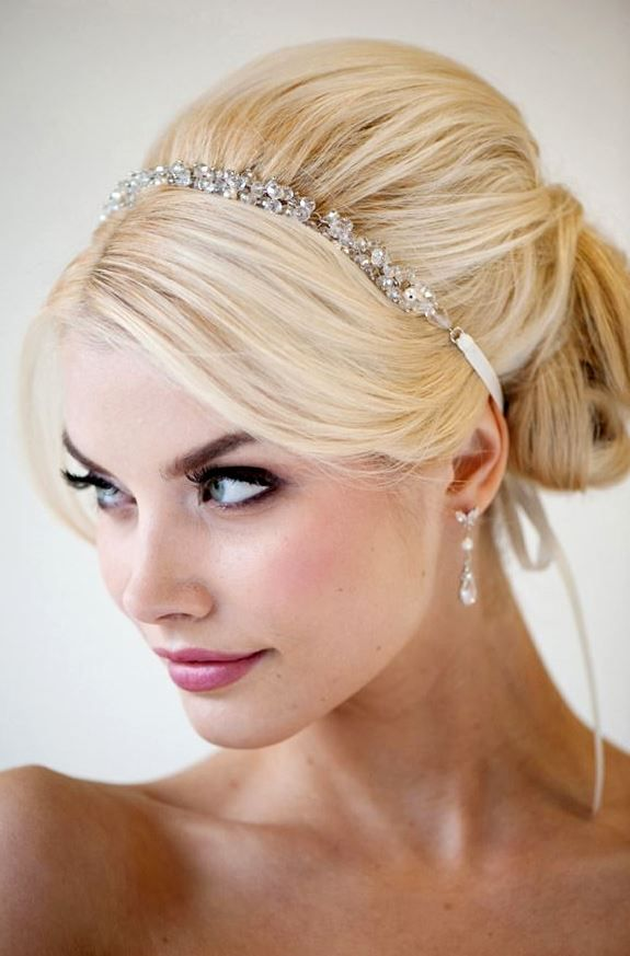 Bride's side part bouffant chignon with hair jewelry bridal hair ideas Toni Kami Wedding Hairstyles ♥❸