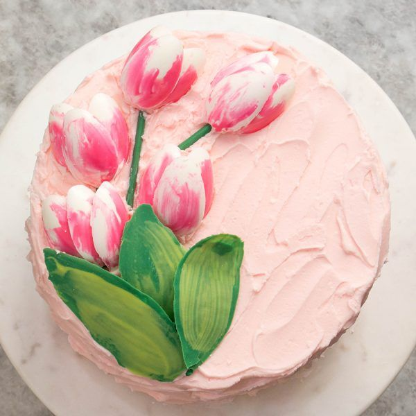 How to make gorgeous tulip cake decorations using melted chocolate and a plastic spoon! A simple technique for Easter, Mother's Day or spring birthday cakes!