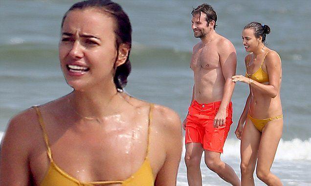 Irina Shayk stuns in bikini as she hits the beach with Bradley Cooper