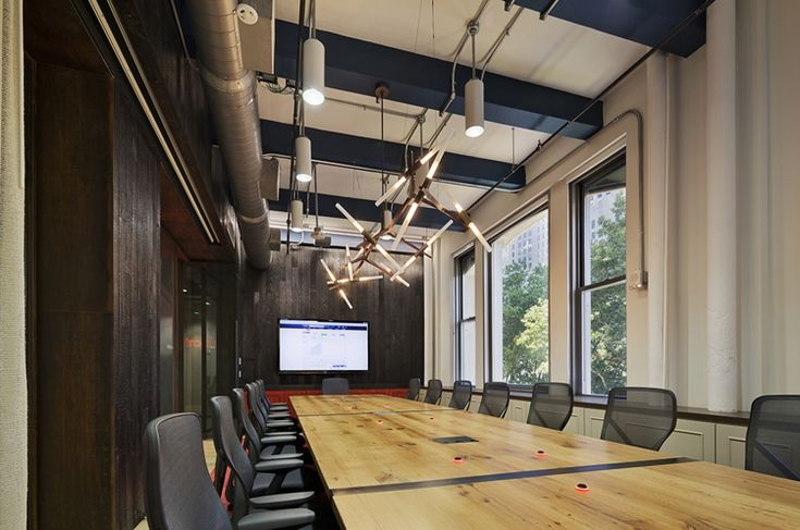 Awesome meeting space with dark & medium wood tones - Jump Trading Office Design