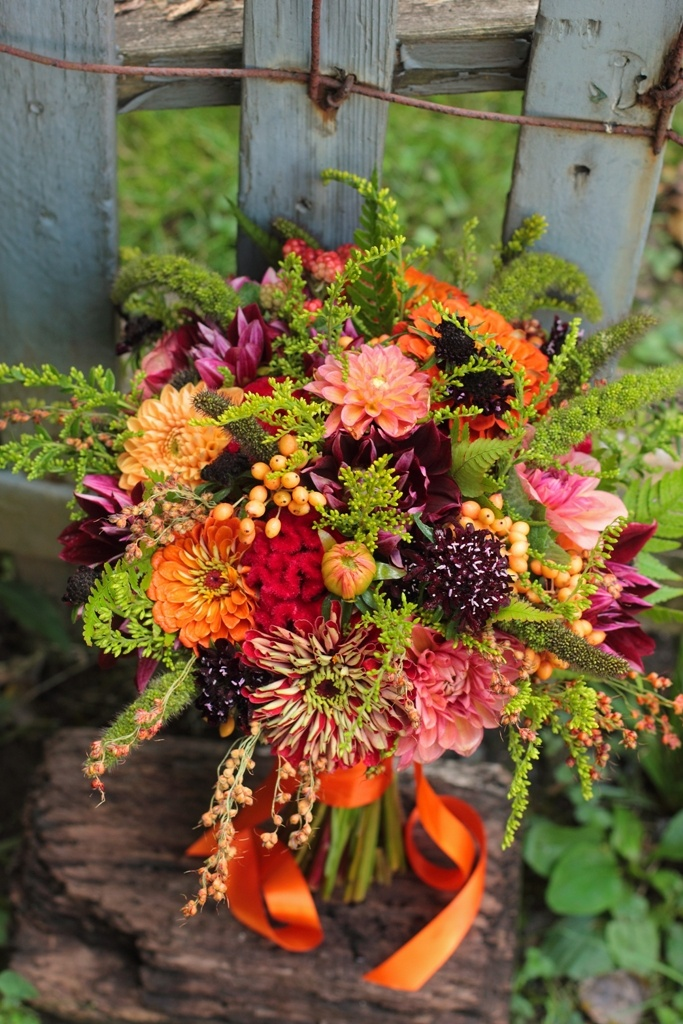 Early September with zinnias, dahlias, pin cushion flowers, solidago, viburnum berries, and more